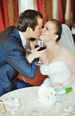Glass of vine and happy groom and bride — Stock Photo