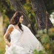 Stock Photo: Bride enjoying in forest