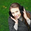 Young woman in fur headphones — Stock Photo