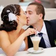 Bride kissing groom — Stock Photo