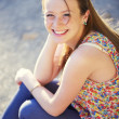 Beautiful smiling red-haired girl. — Stock Photo