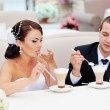 Beautiful young wedding couple drinking cappuccino. — Stock Photo