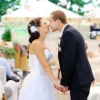 Stock Photo: Young caucasiwedding couple kissing