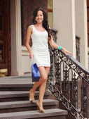 Beautiful woman with shopping bag — Stock Photo