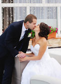 Young caucasian wedding couple kissing — Stock Photo