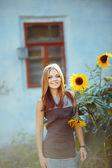 Beautiful girl with sun flower — Stock Photo