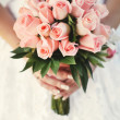 Bride holding bouquet. — Stock Photo #33048793