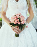 Bride holding bouquet. — Stock Photo