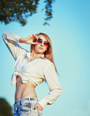 Sexy young woman in sunglasses. — Stock Photo