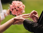 Marry me. Groom put a ring on finger of his lovely wife. — Stock Photo