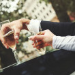 Hands of a wedding heterosexual couple. — Stock Photo