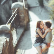 Foto Stock: Sweet teen couple embracing at street.
