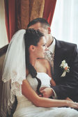 Young wedding couple in restaurant — Stock Photo