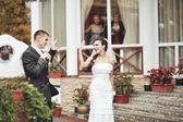 Wedding couple against reastaurant. — Stock Photo