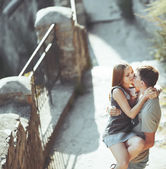 Sweet teen couple embracing at street. — Stock Photo