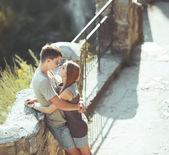 Sweet teen couple embracing at street. — Stock Photo