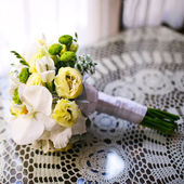 Wedding bouquet of various flowers on table in cafe. — Stock Photo