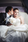 Young couple in limo — Stock Photo