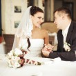 Стоковое фото: Newlywed couple sitting in cafe