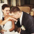 Groom kissing hand of his lovely bride — Stock Photo #34480509