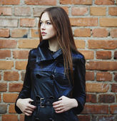 Young woman wearing leather coat — Stock Photo