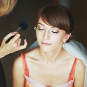Bride having wedding make-up — Stock Photo