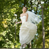Young happy bride jumping. — Foto Stock