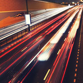 Traffic lights in motion blur on road of Dubai. — Stock Photo