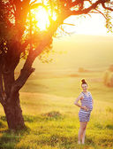 Happy pregnant woman in beautiful garden — Foto Stock
