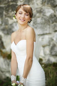 Portrait of happy cheerful smiling bride outdoors — Stock Photo