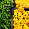 Bell peppers, natural background in shop — Stock Photo