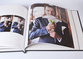 Wedding photo book of elegant young caucasian groom — Stock Photo