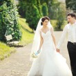Happy wedding couple walking together — Stock Photo #38315315
