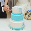Bride and groom cutting wedding cake — Stock Photo #38315369