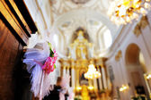 Flower wedding decoration in a church — Stock Photo