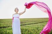 Kobieta w ciąży poza — Zdjęcie stockowe