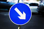 Street sign with arrow — Stock Photo