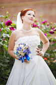 Lovely red hair bride posing with flowers outside. European wedding. — 图库照片