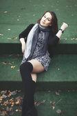 Street portrait of young long hair brunette woman — Stockfoto