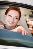 Bride in white limo. — Photo