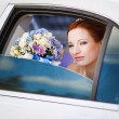 Stock Photo: Lovely red hair bride in white limo