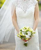 Happy bride outside on wedding day. — Stock Photo