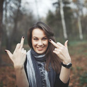 Middle finger of young woman. — Stock Photo