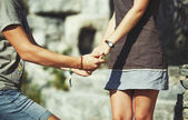 Hands of teen couple — Stock Photo
