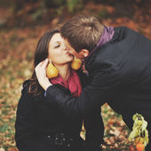 Young couple having date in autumn park. — Stock Photo