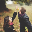 Young sweet couple having date in autumn park. — Stock Photo #43370845