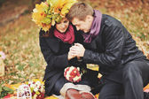 Great relationship. Young sweet couple having date in autumn park. — Stockfoto