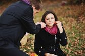 Young couple having fun in autumn park. — Stock Photo