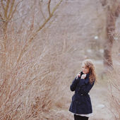 Curly hair woman in coat — Stock fotografie