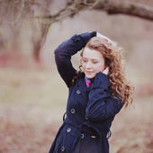 Curly hair woman in coat — Stock Photo